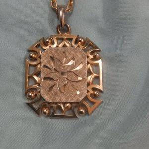 Gold tone pendent necklace